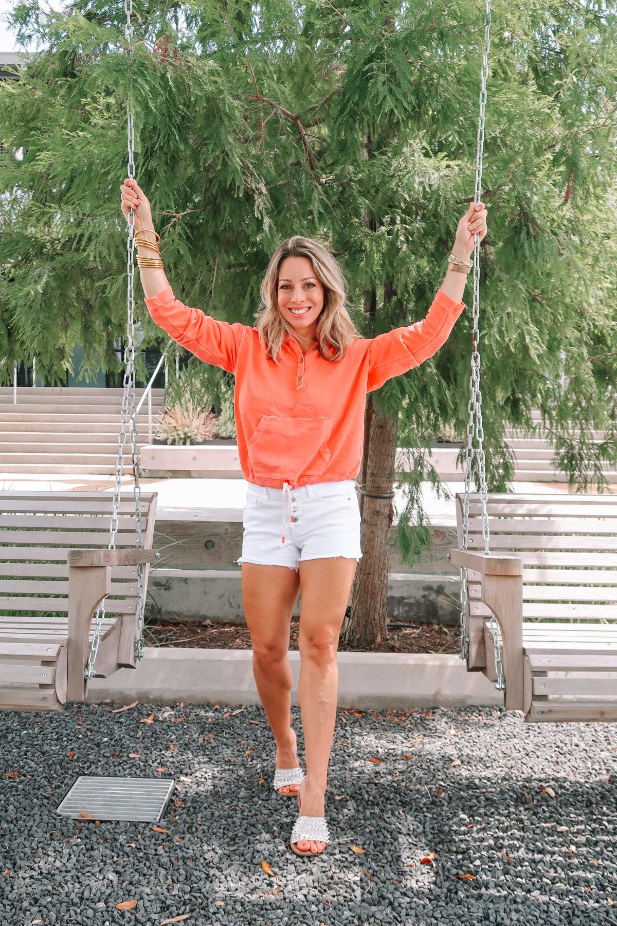 Orange Pullover, White Button Fly Denim Shorts, Studded Slides