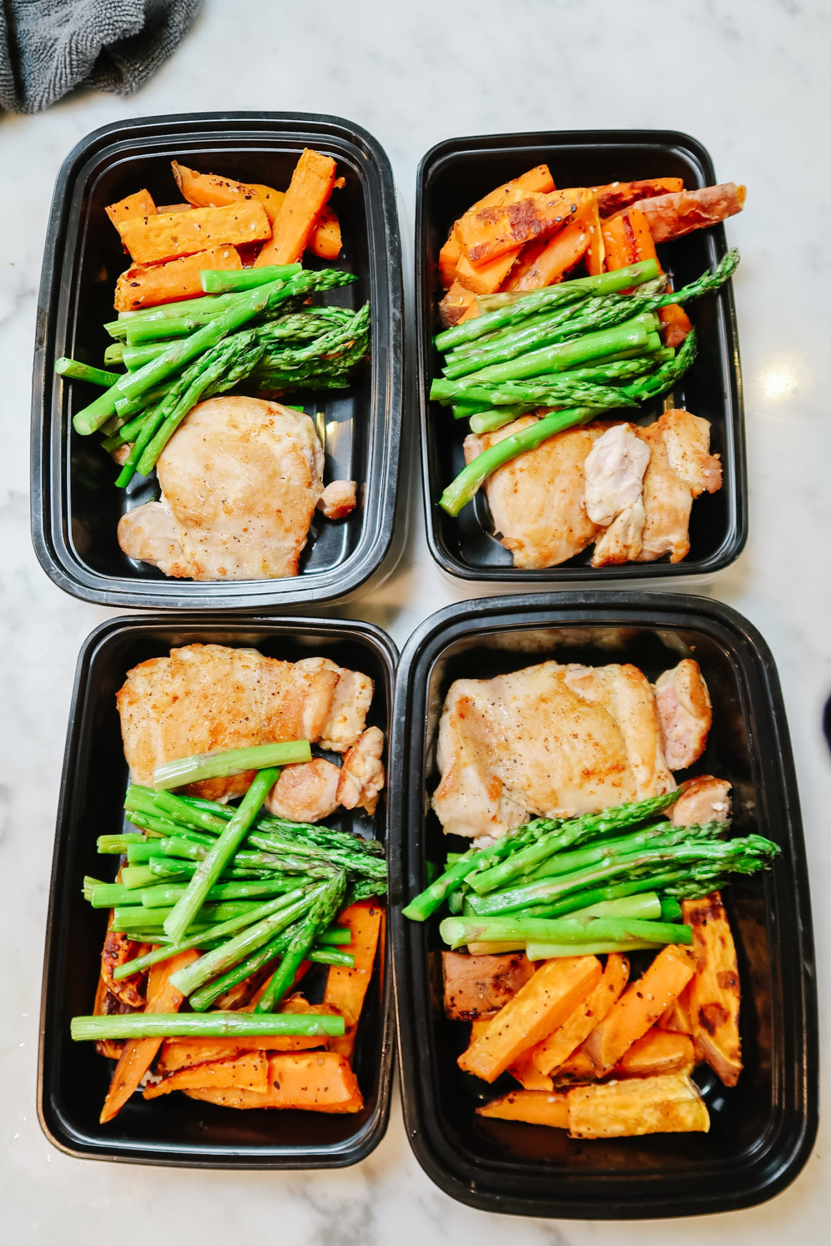 CHICKEN THIGHS WITH ASPARAGUS & SWEET POTATO FRIES