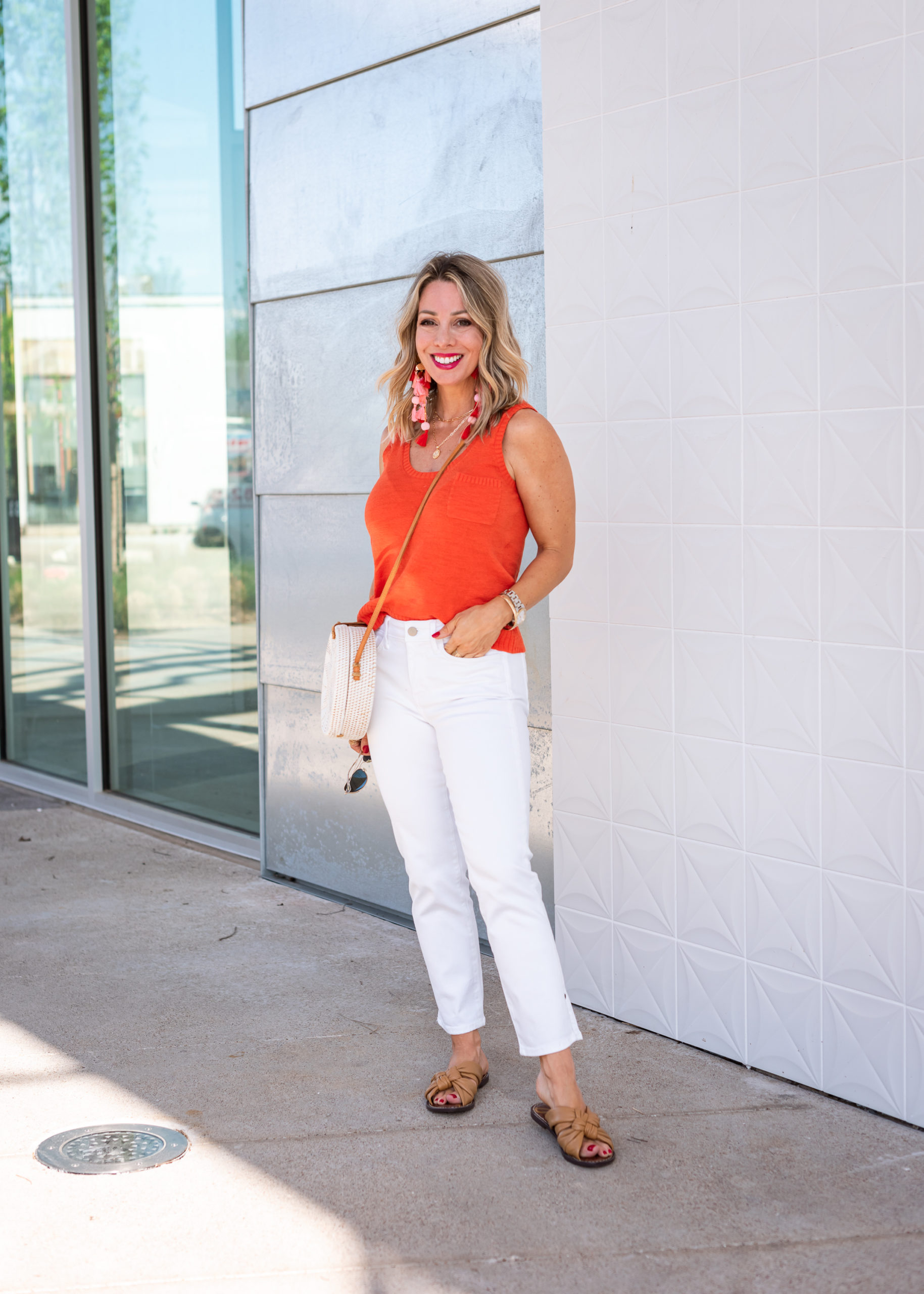 Orange Sweater Tank and White Jeans with Knot Sandals and woven Circle Bag